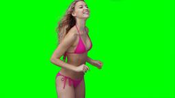 A woman in a bikini using a beachball Footage
