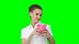 A woman holding her piggybank in her hands as she Stock Video Footage