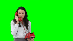 A business woman using a red telephone Footage
