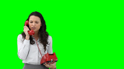 A business woman using a red telephone Stock Video Footage