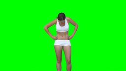 A woman in training clothes checks her figure Footage