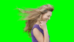 A woman with her hair blowing blowing kisses and f Footage