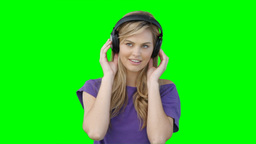 A woman moving to the music on her headphones Footage