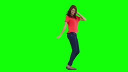 A happy woman is dancing on her own Footage