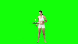 A woman is playing with a tennis racket and ball Stock Video Footage