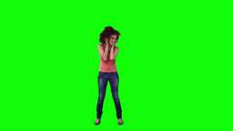 A woman wearing headphones is dancing Stock Video Footage