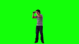 A smiling man is looking through binoculars Stock Video Footage