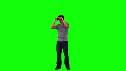 A smiling man is looking through binoculars Stock Video Footage