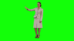 A businesswoman is using a virtual touch screen Stock Video Footage