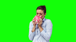 Brunette in slow motion holding a piggy bank Footage