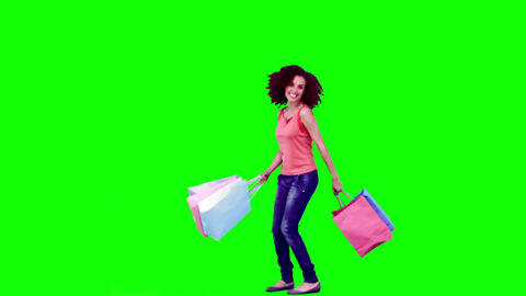 Woman in slow motion holding shopping bags Footage