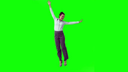 Happy brunette in slow motion raising her arms Stock Video Footage