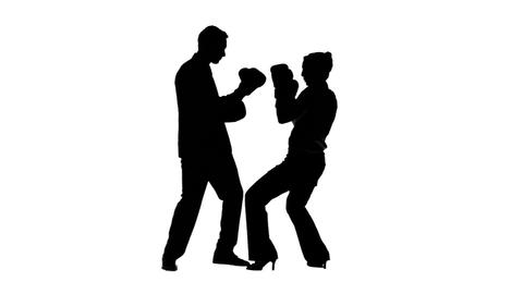 Silhouettes of colleagues in slow motion boxing Live Action