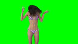 Girl in bikini jumping Footage