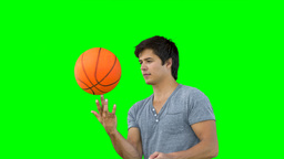 Man spinning a basketball Footage