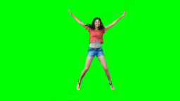 Woman performing a jumping jack Footage