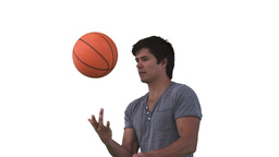 Man spinning a basketball in slow motion Stock Video Footage