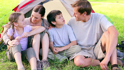Happy family sitting on the grass Footage
