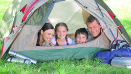 Smiling family lying in a tent Footage