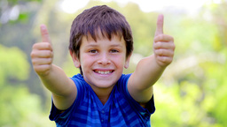 Little boy placing his thumbs up Footage