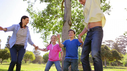 Happy family dancing together on the grass Footage