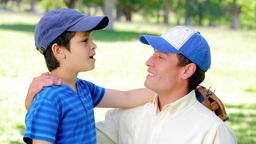 Father and son wearing baseball caps Footage