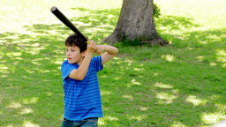 Smiling child playing baseball with his father Footage