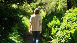 Woman walking in a park Footage