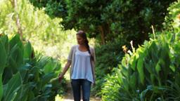 Woman strolling on a footpath Footage