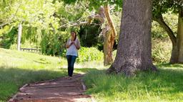 Woman walking on a footpath Footage