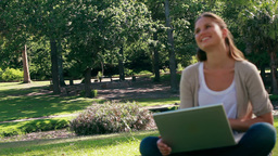 Woman laughing while using a laptop Stock Video Footage