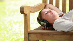 Young woman lying on a bench Stock Video Footage
