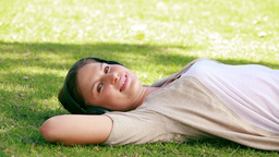 A woman is lying on grass Stock Video Footage