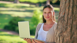 A woman is holding a laptop Footage