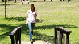 Woman crossing a small bridge Footage