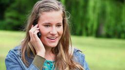 Joyful woman using a cellphone Live Action
