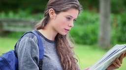 Young serious woman reading a notebook Stock Video Footage