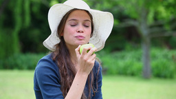 Cheerful woman eating a green apple Stock Video Footage