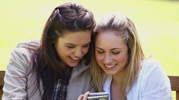 Smiling friends looking at a digital camera Footage