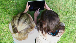 Happy friends using a tablet computer Stock Video Footage