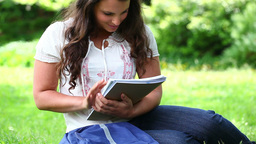 Smiling brunette woman holding notebooks Footage