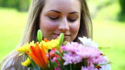 Happy young woman holding flowers Footage