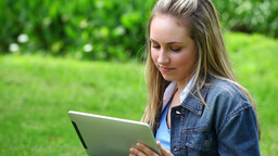 Happy blonde woman using a tablet computer Footage