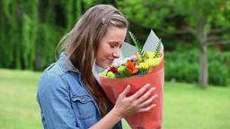 Young woman holding a bunch of flowers Stock Video Footage