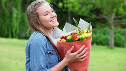 Young woman holding a bunch of flowers Footage