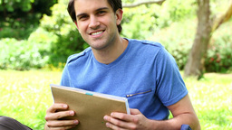 Happy man taking his notebooks Stock Video Footage