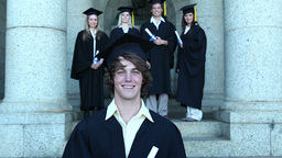 Graduates smiling as they pose Stock Video Footage