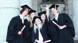 Graduates take self portrait together Footage