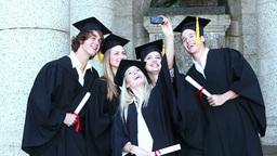 Graduates take self portrait together Footage