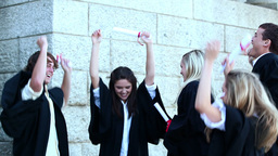 Graduates throwing mortar boards and dancing Stock Video Footage